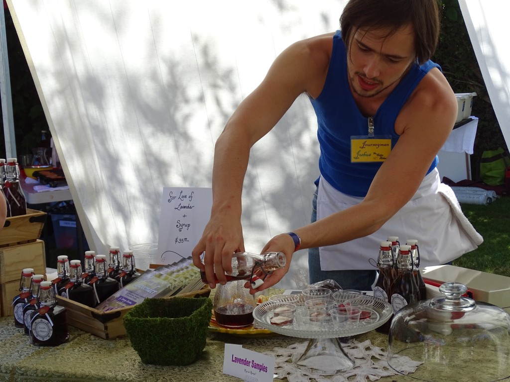 purple haze lavender festival amanda knox journeyman joshua pouring samples of lavender syrup by the hidden alchemist